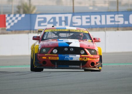 DUBAI - JANUARY 14: Car 27, a Ford Mustang GT3, during the morning hours of the 2012 Dunlop 24 Hour Race at Dubai Autodrome on January 14, 2012. Stock Photo - 12060226