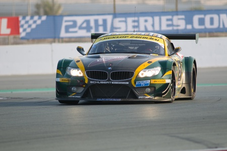 gt3: DUBAI - JANUARY 14: Car 5, a BMW Z4 GT3, during the morning hours of the 2012 Dunlop 24 Hour Race at Dubai Autodrome on January 14, 2012. Editorial