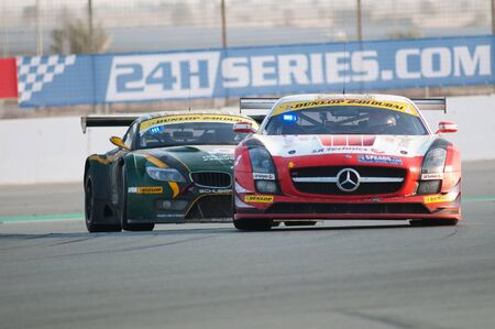 gt3: DUBAI - JANUARY 14: Race winner, a Mercedes SLS AMG GT3 in front of last years winner, a BMW Z4 GT3, during the morning hours of the 2012 Dunlop 24 Hour Race at Dubai Autodrome on January 14, 2012.