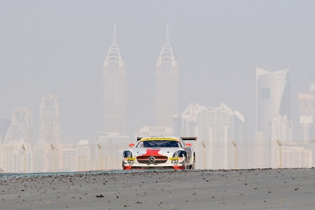 gt3: DUBAI - JANUARY 14: Car 6, a Mercedes SLS AMG GT3 with Dubai City in the background, during the 2012 Dunlop 24 Hour Race at Dubai Autodrome on January 14, 2012. Editorial
