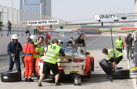 DUBAI - JANUARY 14: Car 18, a Mercedes SLS AMG GT3, during pit stop at the 2012 Dunlop 24 Hour Race at Dubai Autodrome on January 14, 2012.