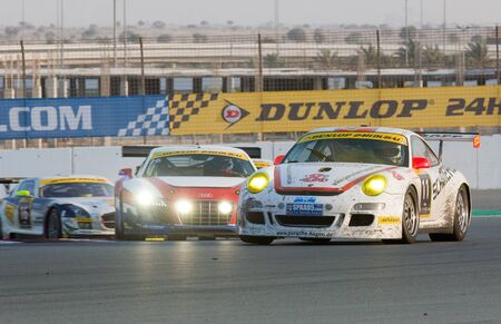 gt3: DUBAI - JANUARY 14: Porsche 997, Audi R8 and Mercedes SLS fighting for positions during the 2012 Dunlop 24 Hour Race at Dubai Autodrome on January 14, 2012. Editorial