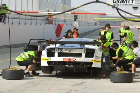DUBAI - JANUARY 13: Car 30, a Lamborghini Gallardo LP600 during pit stop during the 2012 Dunlop 24 Hour Race at Dubai Autodrome on January 13, 2012.