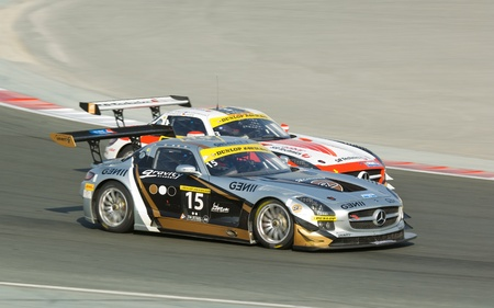 gt3: DUBAI - JANUARY 13: Two Mercedes SLS AMG GT3 competing in the 2012 Dunlop 24 Hour Race at Dubai Autodrome on January 13, 2012.