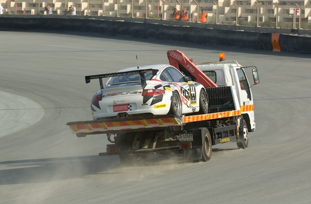 gt3: DUBAI - JANUARY 13: Car 44, a Porsche 997 GT3 Cup, being transported back to the pit after a breakdown during the 2012 Dunlop 24 Hour Race at Dubai Autodrome on January 13, 2012.