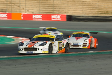 DUBAI - JANUARY 13: Car 117, a Ginetta G50, participating in the 2012 Dunlop 24 Hour Race at Dubai Autodrome on January 13, 2012. Stock Photo - 12060265