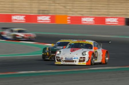 gt3: DUBAI - JANUARY 13: Car 18, a Porsch 997 GT3 R, participating in the 2012 Dunlop 24 Hour Race at Dubai Autodrome on January 13, 2012.