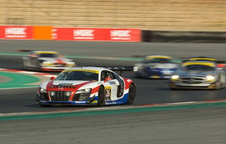 24 26: DUBAI - JANUARY 13: Car 26, an Audi R8 GT3 LMS, participating in the 2012 Dunlop 24 Hour Race at Dubai Autodrome on January 13, 2012. Editorial