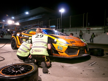 DUBAI - JANUARY 13: Car 29, a Lamborghini Gallardo LP600 during pit stop at night during the 2012 Dunlop 24 Hour Race at Dubai Autodrome on January 13, 2012.