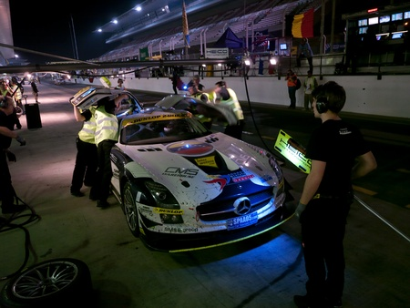 pit stop: DUBAI - JANUARY 13: Car 16, a Mercedes SLS AMG GT3 during pit stop at night at the 2012 Dunlop 24 Hour Race at Dubai Autodrome on January 13, 2012.