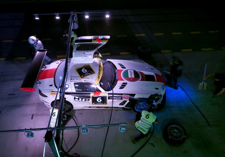 gt3: DUBAI - JANUARY 13: Aerial view of car 6, a Mercedes SLS AMG GT3 during pit stop at night at the 2012 Dunlop 24 Hour Race at Dubai Autodrome on January 13, 2012.