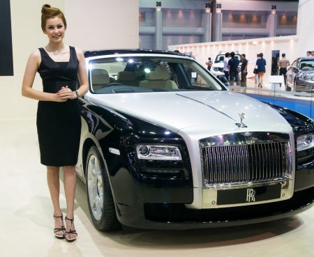 BANGKOK - MARCH 28: A representative from Rolls Royce shows their Rolls Royce Ghost at the 33rd Bangkok International Motor Show at Impact Challenger on March 28, 2012 in Bangkok, Thailand. Editorial