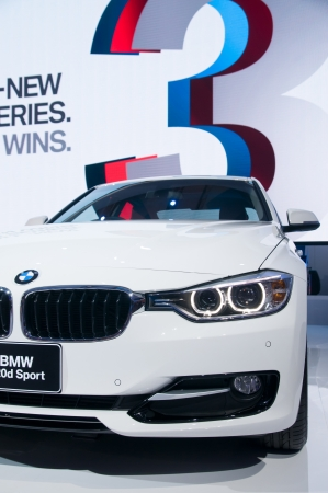 BANGKOK - MARCH 28: BMW shows a white 320d Sport at the 33rd Bangkok International Motor Show at Impact Challenger on March 28, 2012 in Bangkok, Thailand.