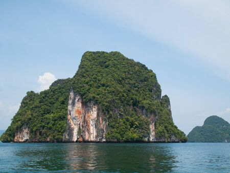 Cliff island at Phang Nga Bay in the Andaman Sea off the coast of Krabi, Thailand photo