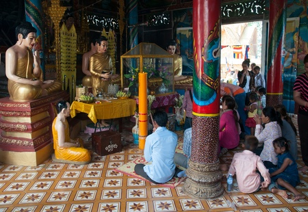 yat: PAILIN - APRIL 14: Buddhists making merit at the Buddhist temple of Phnom Yat during Songkran celebration in Pailin, Cambodia on April 14, 2012.