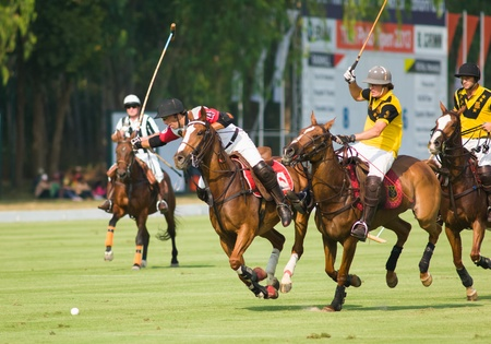 PATTAYA - JANUARY 19: Players fighting for the ball during the bronze final between Ranhil and Royal Pahang at Thai Polo Open on January 19, 2013 in Pattaya, Thailand.