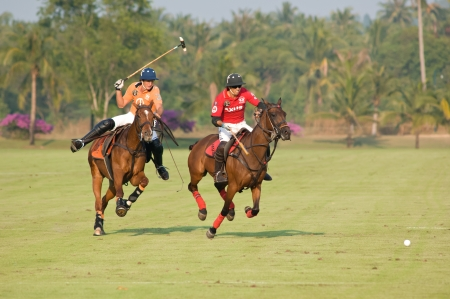 PATTAYA - JANUARY 19: Players fighting for the ball during the final between Thai Polo and Axus Polo at Thai Polo Open on January 19, 2013 in Pattaya, Thailand. Editorial