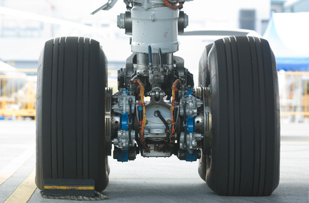 aircraft landing: Rear landing gear of Boeing 787 wide-body airplane