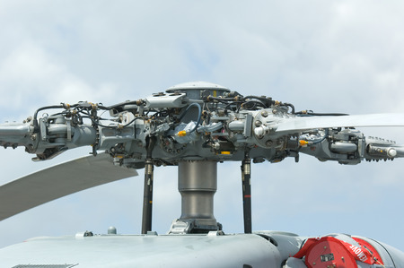 Rotor head of 4-bladed, large military helicopter Фото со стока