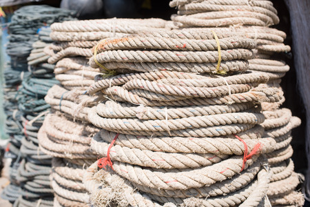 chandler: Coils of used ropes at ship chandler in Myeik, Myanmar. Shallow depth of field. Stock Photo