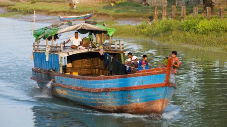 third world: Sittwe Rakhine State Myanmar  October 16 2014: Cargo vessel navigating a canal near Sittwe the capital of the Rakhine State in Myanmar. Editorial