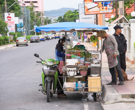 here's: Pattaya City Thailand  June 26 2015: Thailand is famous for its street food which is tasty and can be bought everywhere around the clock. Heres a mobile kitchen selling meatballs and the spicy papaya salad som tam.