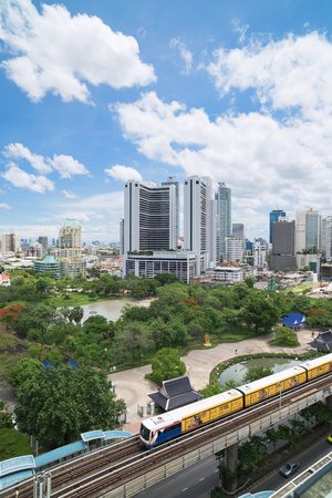 railway transportations: Bangkok, Thailand - May 22, 2015: With the BTS Skytrain, opened in 1999, Bangkok has developed fast in areas near the train stations, like here at Phrom Phong Station on the Sukhumvit line.