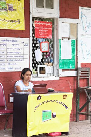 ticketing: Yangon, Myanmar - July 5, 2015: Myanmars old fashioned but popular railway system has introduced computerized ticketing in Yangon, utilizing tablet computers to issue tickets. Editorial