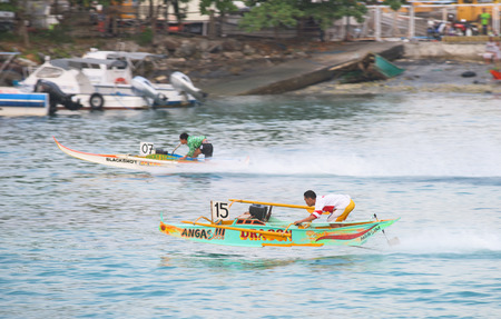 17th: General Santos City, The Philippines - September 6, 2015: Two participants with their motorised outrigger boats at the bancarera race during the 17th Annual Gensan Tuna Festival 2015. Editorial