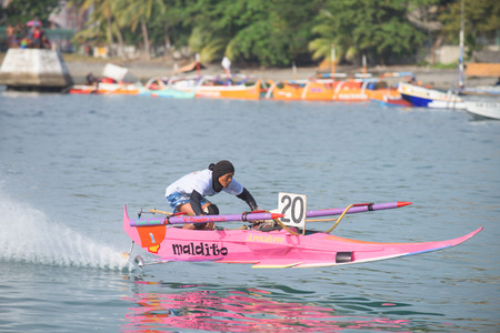participant: General Santos City, The Philippines - September 6, 2015: Participant with his outrigger boat at the bancarera race during the 17th Annual Gensan Tuna Festival 2015. Editorial