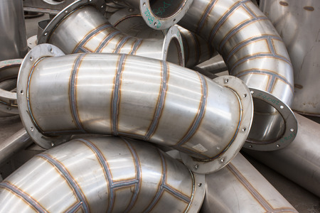 Unfinished parts for stainless steel industrial ducting during production.