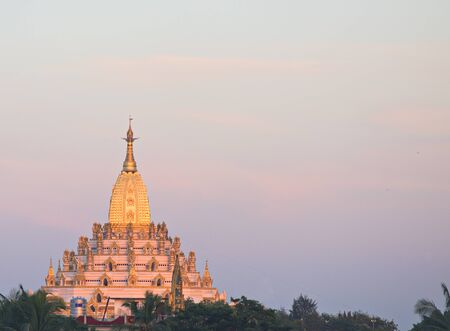 daw: The Swal Daw Pagoda in Yangon, Myanmar at sunset.