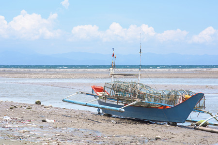 beached: Beached fishing vessel at General Santos City, the southernmost city of The Philippines.
