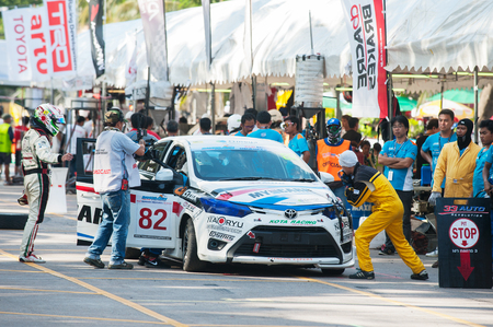 pit stop: Bang Saen, Thailand - November 27, 2015: Pit stop and driver change for a team during the 6 hour race street race during Bang Saen Speed Festival at Bang Saen, Chonburi, Thailand.