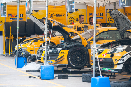 gt3: Bang Saen, Thailand - November 28, 2015: The cars of the B-Quik Racing Team, an Audi R8 and a Porsche 997 GT3 Cup, being prepared for Bang Saen Speed Festival at Bang Saen, Chonburi, Thailand.