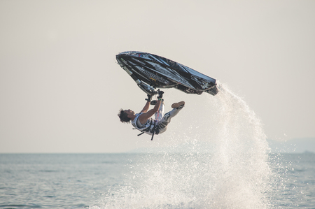 moto acuatica: Pattaya, Thailand - December 6, 2015: Taiji Yamamoto from Japan during his performance at the freestyle competition during the International Jet Ski World Cup at Jomtien Beach, Pattaya, Thailand.
