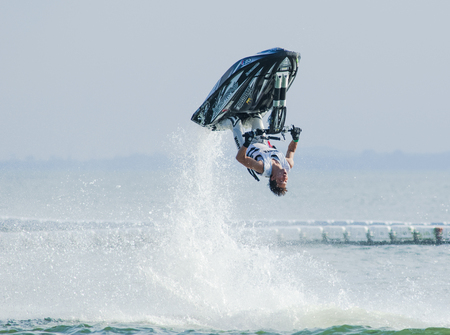taiji: Pattaya, Thailand - December 6, 2015: Taiji Yamamoto from Japan during his performance at the freestyle competition during the International Jet Ski World Cup at Jomtien Beach, Pattaya, Thailand.