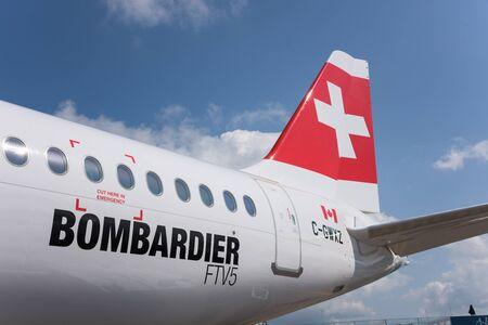 bombardier: Singapore - February 16, 2016: Rear part of a Bombardier CS100 medium range airliner in Swiss livery during Singapore Airshow at Changi Exhibition Centre in Singapore.