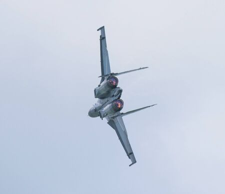 russian: Rear shot of Russian, twin engined, supersonic jet fighter during an air show performance.