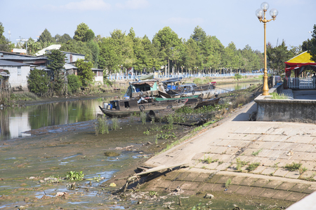 waterways: Cao Lanh, Vietnam - March 19, 2016: Due to El Nino and an increasing number of dams upstream, The Mekong Delta is seeing its worst drought in decades, with empty waterways and dry rice fields.
