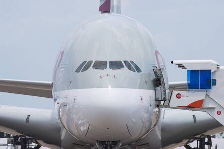 livery: Singapore - February 17, 2016: Front of an Airbus A380 in the livery of Qatar Airways during Singapore Airshow at Changi Exhibition Centre in Singapore.