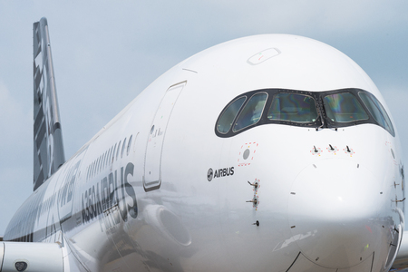 Singapore - February 17, 2016: Front of an Airbus A350 XWB in Airbus factory livery during Singapore Airshow at Changi Exhibition Centre in Singapore.