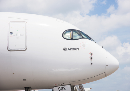 Singapore - February 17, 2016: Front section of an Airbus A350 XWB in Airbus factory livery during Singapore Airshow at Changi Exhibition Centre in Singapore.