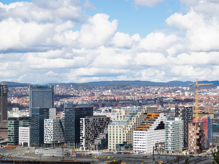 oficina antigua: Oslo, Norway - April 10, 2016: The Barcode project, a redevelopment of a former industrial estate in the Bjorvika area of Oslo, Norway, with a row of high-rise office buildings, each with its own individual style.