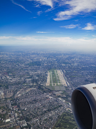 runways: Aerial photo of Bangkok, Thailand, with Don Mueang International Airport, the cityâ??s budget airline airport, in the foreground and Bangkok downtown in the background. Notice the 9-hole golf course between the runways at the airport.