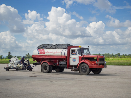 relies: Myeik, Myanmar - June 8, 2016: Due to lacking road and railway infrastructure, Myanmar relies heavily on air transport for travelling. Technology is often basic, like the refueling gear at Myeik Airport in Tanintharyi Region. Editorial