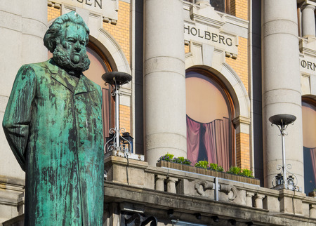 screenwriter: Statue of Henrik Ibsen, one of the greatest playwrights ever, in front of the National Theatre in Oslo, Norway. The statue was made by Stephan Sinding and erected in 1899. Ibsen died in 1906. Editorial