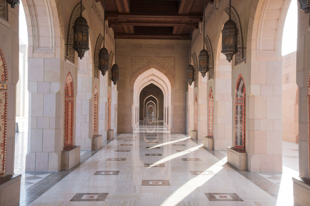 muscat: Muscat, Oman - February 28, 2016: Archway at Sultan Qaboos Grand Mosque in Muscat, Oman. This is the largest and most decorated mosque in this mostly Muslim country.