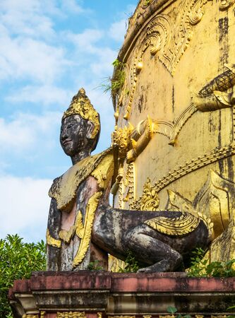 Detail of old pagoda at the Moe Hnying Monastery in Yangon, Myanmar. Sculpture of hybrid creature with human head and animal body in the foreground. Reklamní fotografie
