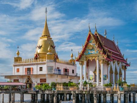 decades: Bang Pakong, Thailand - July 16, 2017: Wat Hong Thong, a temple built on a concrete platform at the coast of Chachoensao in Thailand after the sea started to reclaim the area of the original temple several decades ago as a result of erosion.